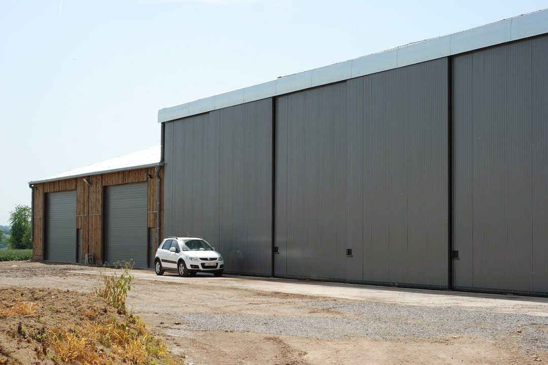 Portes sectionnelles et coulissantes